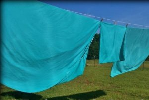 My homemade laundry detergent smells great but sometimes you want a stronger scent. Making a scent booster is inexpensive and easy! #TxHomesteader