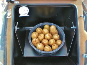 I'm using my solar oven almost every day for the last few weeks - I LOVE IT! See how I cooked baked potatoes without adding any heat to my Texas kitchen. #TexasHomesteader