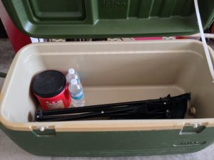 Large cooler for storage and seating.  Our Emergency Preparedness list of items needed in our underground storm shelter. #TxHomesteader