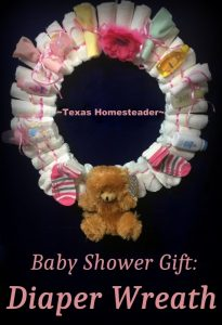 An easy diaper wreath, customizable for either boy or girl. A decorative (yet useful) gift presented beautifully! #TxHomesteader