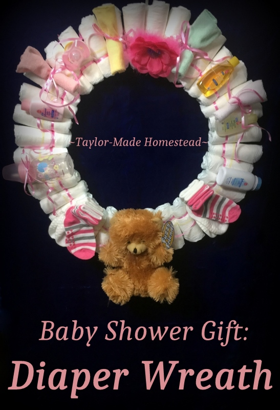 An easy diaper wreath, customizable for either boy or girl. A decorative (yet useful) gift presented beautifully! #TaylorMadeHomestead