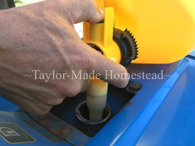 Hard as he may try, RancherMan would always splash fuel when filling my tractor's tank. Let's try this No-Spill can & see how it works! No-Spill Gas Can Filling Blue Tractor #TaylorMadeHomestead