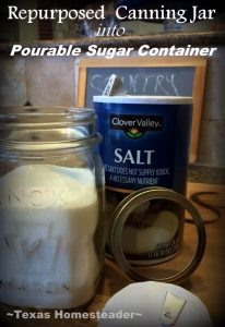 She uses a repurposed canning jar & a salt container spout destined for the recycling bin to make a convenient pourable sugar jar! #TexasHomesteader
