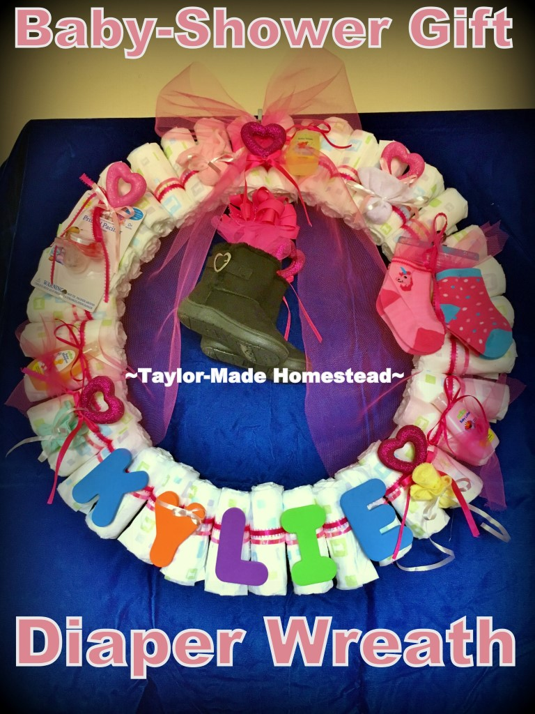 Cute Diaper Wreath Gift For Baby. This gift didn't cost much money but it was hand-made with much love. #TaylorMadeHomestead
