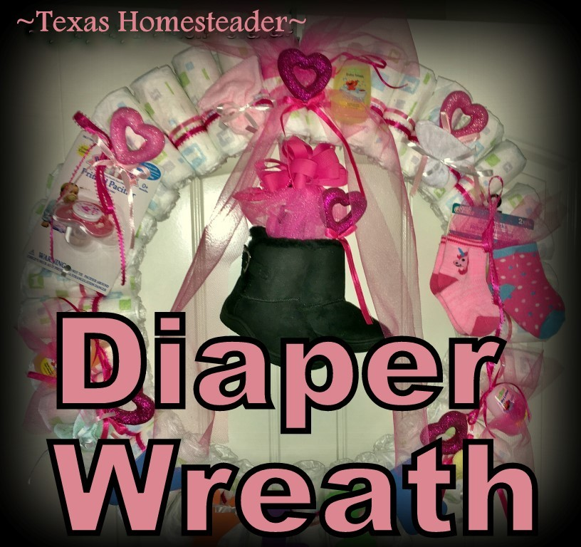 Cute Diaper Wreath Gift For Baby. This gift didn't cost much money but it was hand-made with much love. Items can be pulled from the wreath as needed. #TexasHomesteader