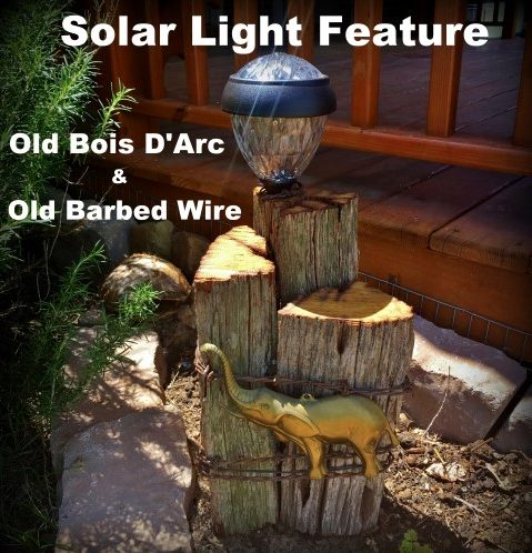 Rustic solar light feature using old, aged Bois D'Arc wood and rustic old barbed wire, metal elephant embellishment & decorative solar light. #TexasHomesteader