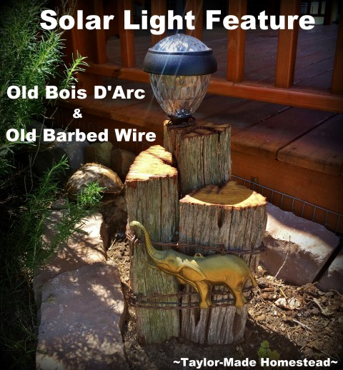 Rustic solar light feature using old, aged Bois D'Arc wood and rustic old barbed wire, metal elephant embellishment & decorative solar light. #TaylorMadeHomestead
