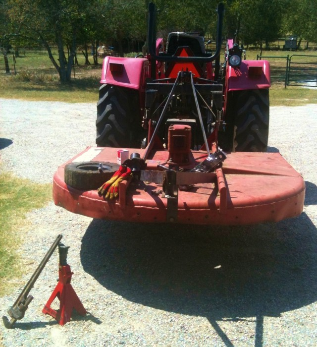 repairing brokenn tractor. Being a farmer or rancher is a labor of love. #TexasHomesteader