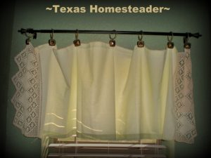 Repurposing my great-grandmothers dresser scarves into window coverings has beautiful results! Plus I was able to add bathroom privacy. #TexasHomesteader