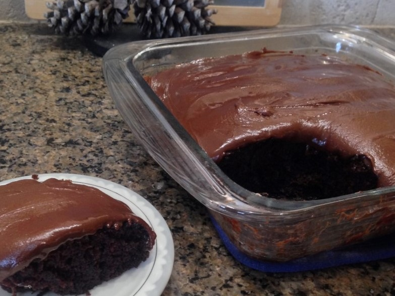 DEPRESSION-ERA CHOCOLATE CRAZY CAKE RECIPE - no eggs, butter, milk or even BOWLS! Quick & easy with BONUS no-cook chocolate frosting recipe! #TexasHomesteader
