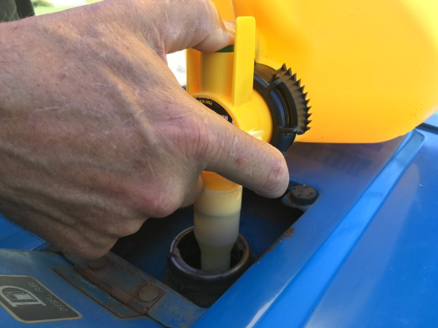 Hard as he may try, RancherMan would always splash fuel when filling my tractor's tank. Let's try this No-Spill can & see how it works! #TexasHomesteader