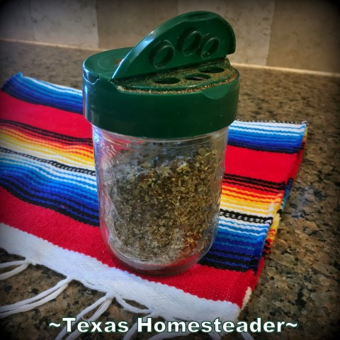 BBQ Rub container with easy access. I place a repurposed parmesan cheese lid on a standard 1/2-pint canning jar. See how it simplifies my life in the kitchen. #TexasHomesteader