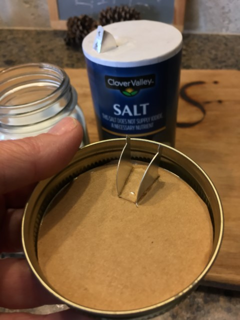 Cut top of salt container, insert into canning ring. Then screw into canning jar to use the pouring spout to make a convenient pourable sugar jar! #TexasHomesteader
