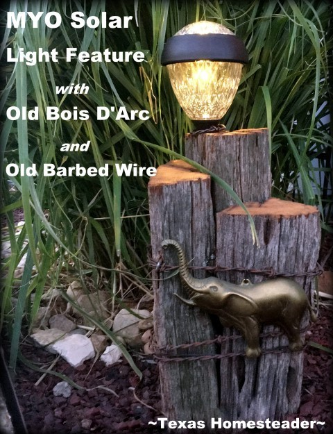 Solar light feature using old, aged Bois D'Arc wood and rustic old 1880's barbed wire, a metal elephant embellishment and decorative solar light. Perfect! #TexasHomesteader
