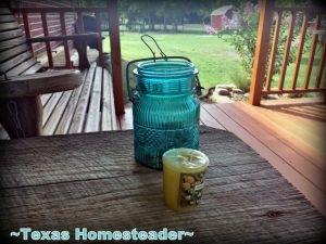 I used an old broken flip-top jar, some gravel and a small votive candle to make the cutest porch lantern ever. Come see! #TexasHomesteader