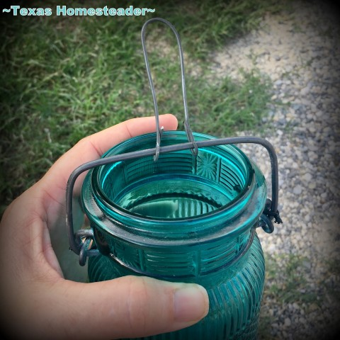 Making a hanging loop on my candle jar. I used an old broken flip-top jar, some gravel and a small votive candle to make the cutest porch lantern ever. Come see! #TexasHomesteader