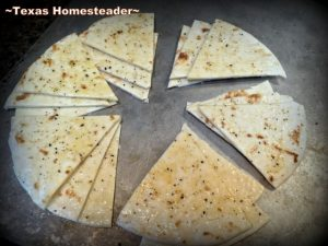 Cutting oiled tortillas. MYO baked pita chips using only 6 flour tortillas! A nice, heavy chip that holds up to dips or hummus. Nice & crispy too. Come see! #TexasHomesteader