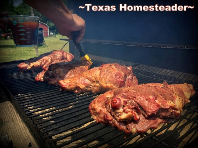 Basting pork roasts being smoked on the grill with pecan wood. Delicious Smoked Pork using pecan wood smoke. Delicious. And shredding all that meat can be done in minutes using our shortcut. #TexasHomesteader