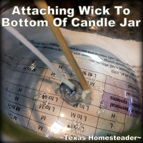 Steady wick to bottom of glass jar. It's easy to make your own natural beeswax jar candles. It's fun, it's easy, and it's natural. And who doesn't love a beeswax candle?? #TexasHomesteader