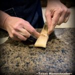 Tying the assembled tamale. It's time consuming to make homemade tamales. But it's very easy. Come see my step-by-step directions complete with photos and recipe. #TexasHomesteader