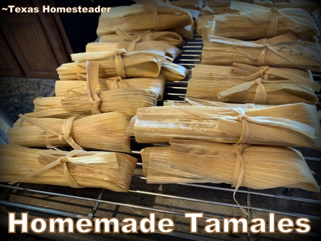Cooling Homemade pork tamales on a rack. It's time consuming to make homemade tamales. But it's very easy. Come see my step-by-step directions complete with photos and recipe. #TexasHomesteader