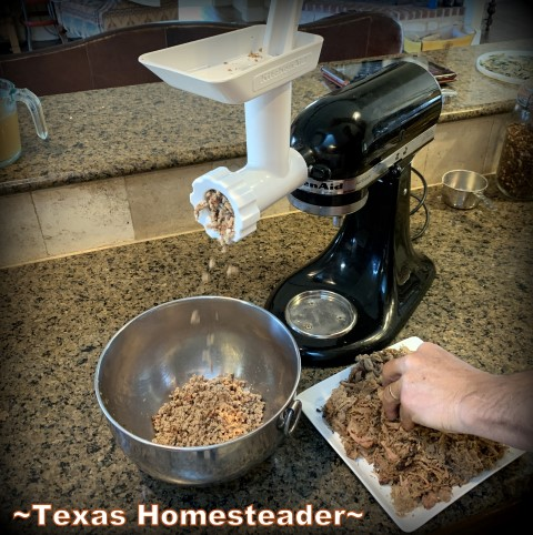 Grinding the shredded pork. It's time consuming to make homemade tamales. But it's very easy. Come see my step-by-step directions complete with photos and recipe. #TexasHomesteader