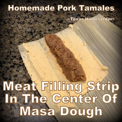 Placing meat in on the masa dough. It's time consuming to make homemade tamales. But it's very easy. Come see my step-by-step directions complete with photos and recipe. #TexasHomesteader