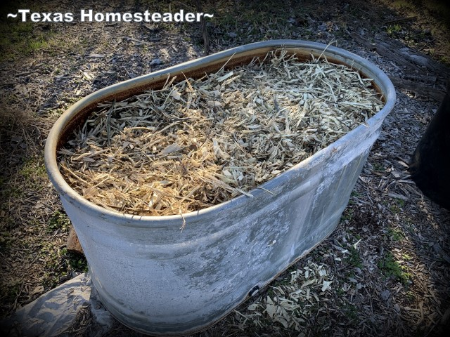 Planting trough topped with wood bark mulch. EcoBricks are plastic bottles packed tightly with non-recyclable trash. They can be used for lots of things, but come see how I use them in the garden. #TexasHomesteader