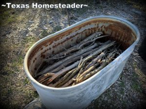 Planting trough filled with limbs as in hugelkultur theory. EcoBricks are plastic bottles packed tightly with non-recyclable trash. They can be used for lots of things, but come see how I use them in the garden. #TexasHomesteader