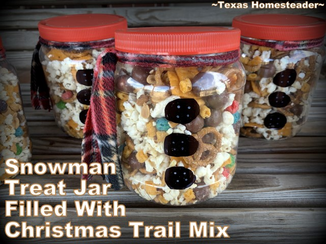 Sweetened popcorn made into Christmas trail mix & placed in decorated snowman jars. #TexasHomesteader